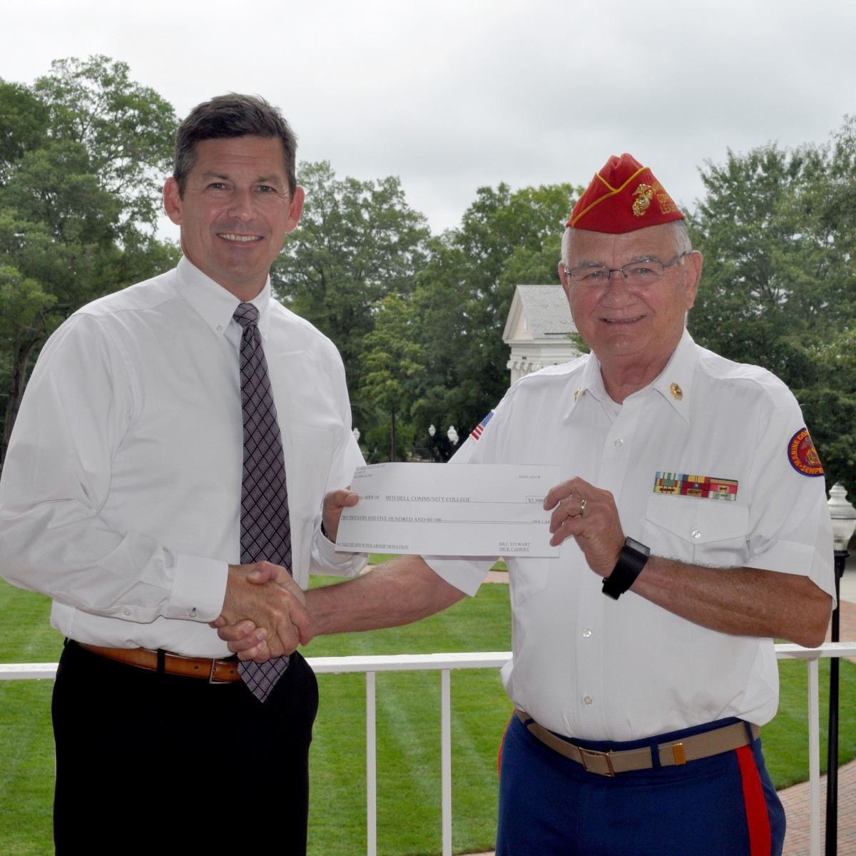 Dr. Tim Brewer, President, Mitchell Community College and Dick Camery, Commandant, Marine Corps League of Iredell County